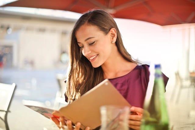 customer smiling over great menu design